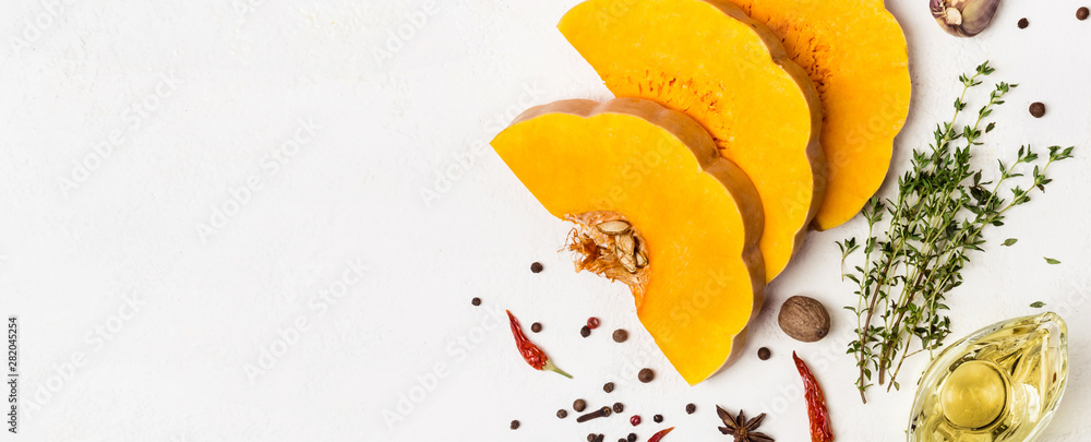 Fototapety, obrazy: Slices of ripe pumpkin with spices and olive oil. Autumn food concept. Banner for site