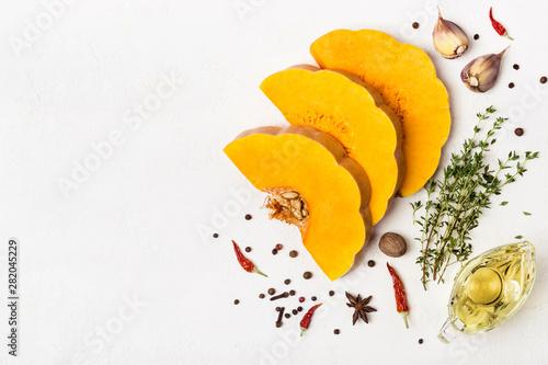 Obraz na płótnie Sliced of raw butternut pumpkin with spices and olive oil