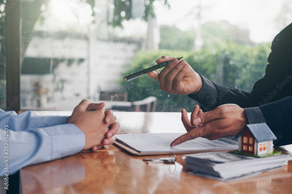 Fototapety, obrazy: real estate agent holding house key to his client after signing contract,concept for real estate, moving home or renting property