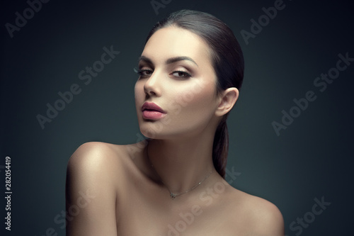 Poster - Sexy beauty brunette woman with perfect makeup. Beauty girl's face on dark background. Skincare