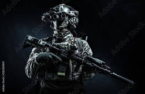 Fotografie, Tablou  Modern combatant wearing night vision device black background