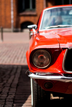 Closeup Of A Red Classic Mustang Parked In Downtown Hannover, Germany