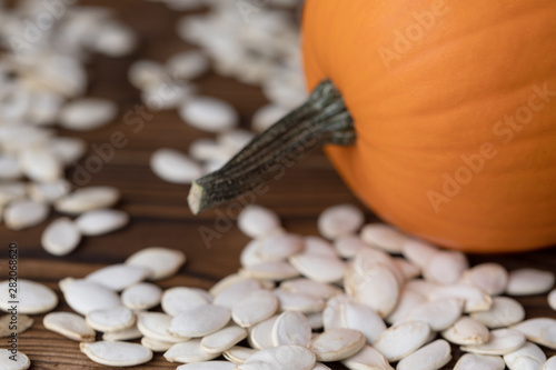 Pumpkin and seeds on wood