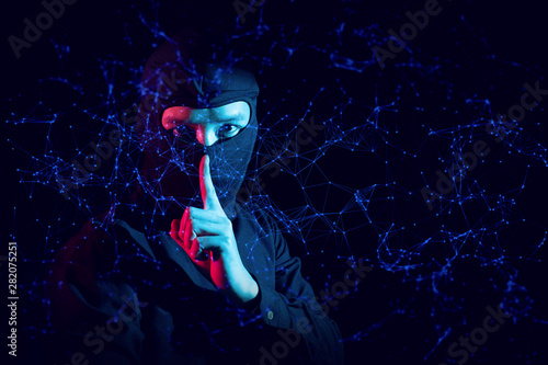 hacker guy in ninja costume with security hack to digital global network ai serv Canvas Print