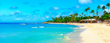 Panoramic View Of The Tropical Beach In Dominican Republic. Coconut Palm Trees On White Sandy Beach.