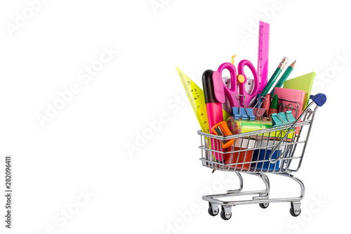 Fotografía Shopping cart with School stationery on white background.
