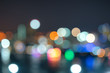 Abstract urban night light bokeh defocused background with sky space area