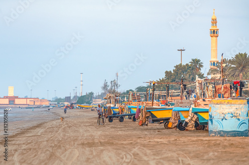 05/11/2019 Bandar Abbas, Hormozgan Province, Iran, many colorful fishing boats on the Persian Gulf coast stand at dawn and wait for the beginning of the working day Slika na platnu