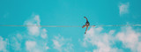 Highliner on the background of blue sky.