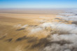 Coastal fog rolling over the desert landscape of Skeleton coast. Skeleton coast, Namibia.