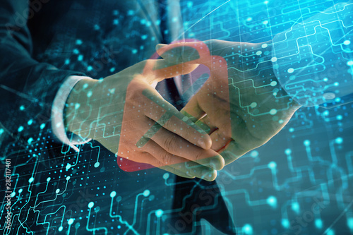 Canvas Prints Countryside Multi exposure of lock icon drawing on abstract background with two men handshake. Concept of data securitization