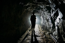 Creepy Backlit Human Silhouette Inside Dark Abandoned Mine