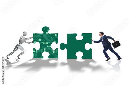 Foto auf AluDibond Akt Robot and human cooperating in jigsaw puzzle