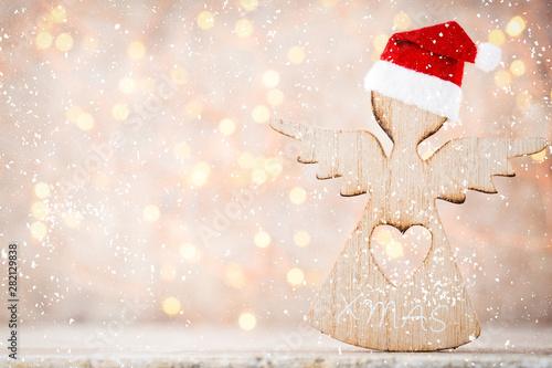 Christmas decor with angel santa hat. Vintages background. - 282129838
