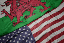 Waving Colorful Flag Of United States Of America And National Flag Of Wales. Macro