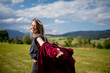 Young woman in red shirt have a fun in a mountains