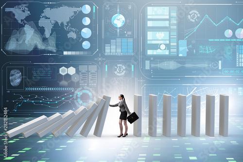 Fotografía  Businesswoman preventing domino effect in business concept