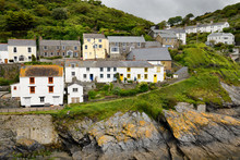 Colorful Window Frames On White Washed Houses On Cliff Of Seaside Village Of Portloe Cornwall England