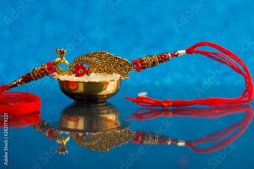 Valokuva  Indian festival Raksha Bandhan , Rakhi with rice grains and kumkum