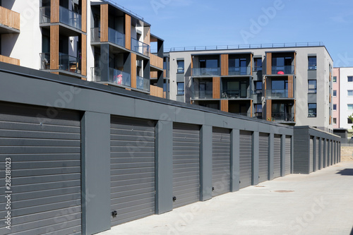 Fotografie, Obraz The new modern standard private steel garages and  low cost  apartments for you