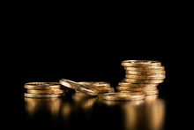 The Concept Of Deposit Accumulation, The Concept Of Money Growth. Scattered Coins. Stack Of Gold Coins On A Black Background.