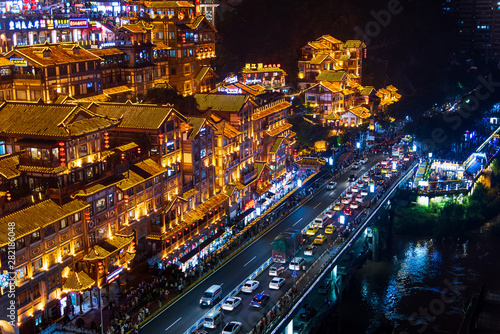 Cuadros en Lienzo  Chongqing, China - July 23, 2019: Hongya cave in Chongqing with modern skyline a