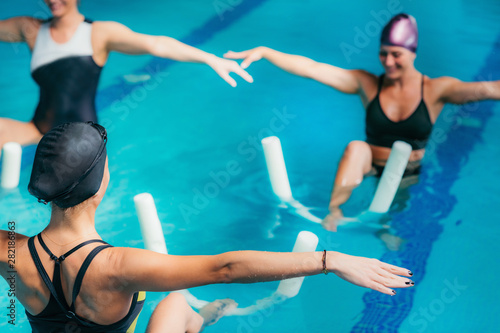 Fototapeta Aqua Aerobic Training with Water Fitness Equipment. obraz