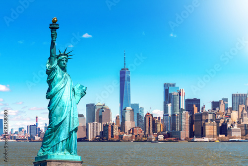 The Statue of Liberty with the One world Trade building center over hudson river and New York cityscape background, Landmarks of lower manhattan New York city. Architecture and building concept - 282188840
