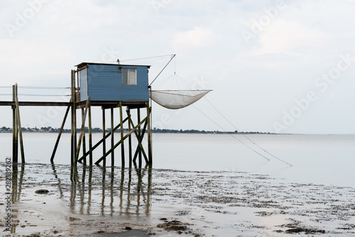 fishing huts on stilts at dusk in Fouras Aquitaine France Fototapet