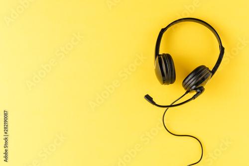 Fototapeta  Customer service headset on yellow background