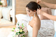 canvas print picture - Professional hairdresser working with young bride at home