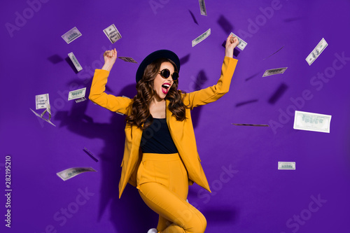 Portrait of her she nice lovely trendy cheerful rich wealthy wavy-haired lady winner currency flying 100 million budget winning isolated over bright vivid shine violet lilac background - 282195210