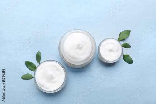 Fototapeta Jars of natural cream on light background obraz na płótnie