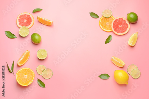 Different sliced citrus fruits on color background - 282198228