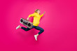 canvas print picture - Full body photo of crazy lady jumping high rushing to student party wear casual outfit isolated pink background