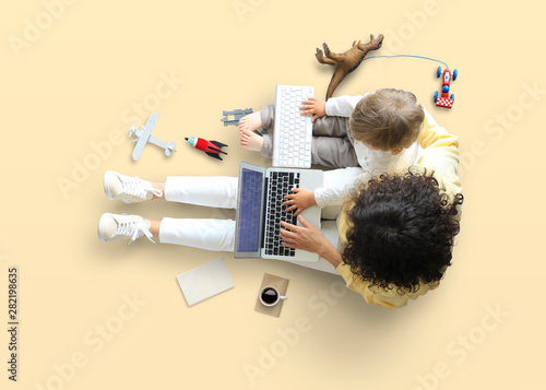 Obraz na płótnie Mother teaches little son to work on the computer, education and childhood