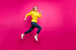 Full length photo of crazy lady jumping high running shopping wear casual outfit isolated pink background