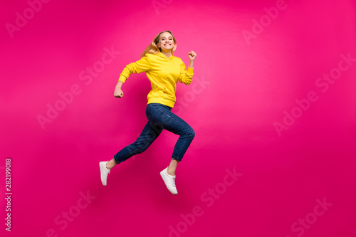Fotografiet  Full length photo of crazy lady jumping high running shopping wear casual outfit