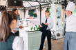 Leinwanddruck Bild - Restaurant manager and his staff in terrace. interacting to head chef in restaurant.