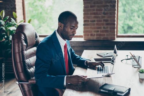 Photo of dark skin guy texting notebook reading paper wear elegant costume sitting office chair