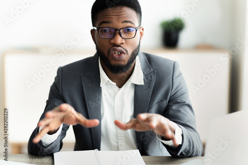 Portrait of handsome businessman looking in camera and talking Canvas Print