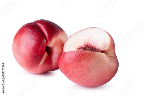 Valokuva  Ripe fresh Nectarine fruit isolated on white background.