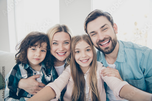Obraz Photo of family two children making selfies weekend great mood best friends - fototapety do salonu