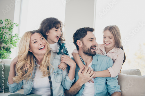 Obraz Closeup photo of four family members after adoption spend time rejoicing giggle sit couch living room - fototapety do salonu