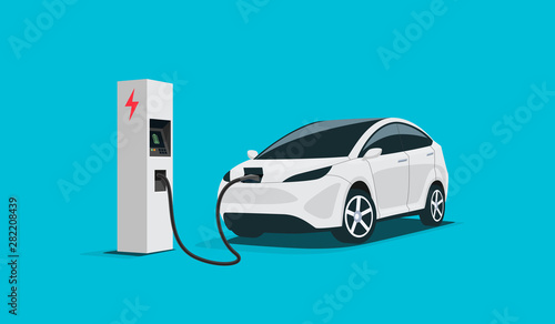 Fotografie, Obraz Modern electric smart suv car charging parking at the charger station with a plug in cable