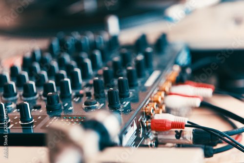 Summer music festival. Dj's sound equipment and people on blurred background.  Shallow depth of field - 282209415