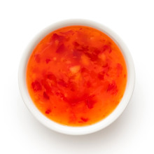 Sweet Chilli Sauce In A White Ceramic Bowl Isolated On White From Above.