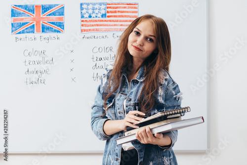 Obraz Female student looking at camera. English language school. - fototapety do salonu