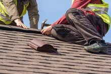 Workman Install Element Of Tile Roof On New Home Under Construction