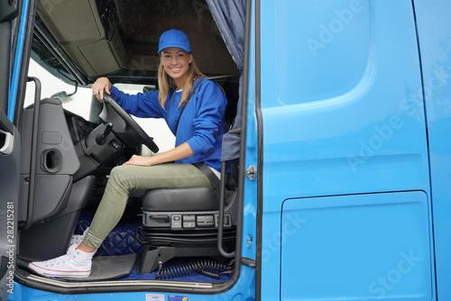 Obraz smiling truck driver woman - fototapety do salonu